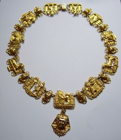 Vintage Gold tone Egyptian Revival Necklace. The surface of this has a lovely matt sheen which is hard to pick up by camera. This is a truly spectacular and very theatrical necklace. It depicts many of the Egyptian deities.