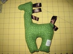 DIY stuffed animal taggie...I will do this with a dinosaur.  Maybe Stegosaurus?