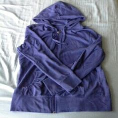 New York & Company Deep Blue Zip Up Hoodie Excellent Used Condition! I only wore this sweater for one winter season. It is thin and stretchy which is great for layering. The color is a deep blue almost purple color. The pockets are cinched as seen in the second picture which is great so your items don't fall out. New York & Company Sweaters