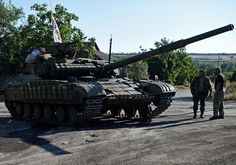 Pro-Russian fighters stand by a T-64 tank in Starobesheve, southeast of Donetsk…