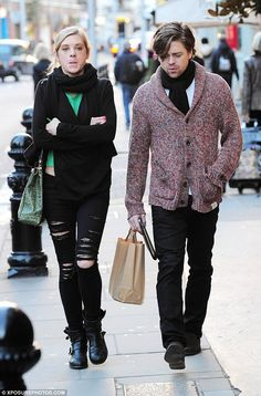 Funny girl: Chelsy pulls a face as she walks down the Chelsea street with her man...