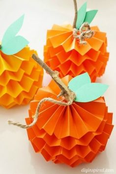 Paper Pumpkin: In this simpler version of a paper pumpkin, sticks, twine, and five different colored papers quickly become a kid-friendly craft. Find more easy and fun DIY Thanksgiving craft ideas for kids here.