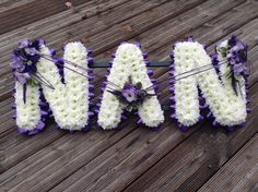 Funeral Flowers. NAN Funeral flower letter tribute Purple and lilac. www.thefloralartstudio.co.uk