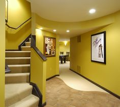 I don't like the color scheme, but I love the way the stairs curve and I love the wall space for portraits and paintings.