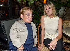 Making friends: Robin smiled next to Michele Sullivan as they chatted at the dinner...