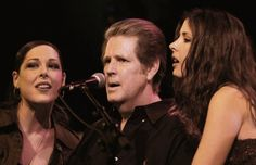8-16 in 1995: Brian Wilson of the Beach Boys performs live for the first time with his daughters Carnie and Wendy, recently famous for their stint in the trio Wilson Phillips.