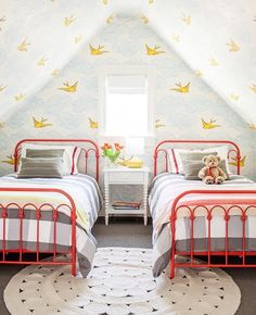 Connecticut Family Getaway Doesn't Take Itself Too Seriously Connected to the attic playroom, this whimsical guest bedroom is all about color. The wallpaper is by Hygge & West and the red twin beds from Walmart