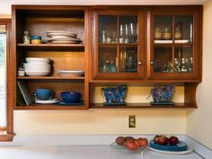 Open-facing wooden cabinets in kitchen.