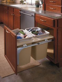 Aristokraft's double wastebasket cabinet keeps trash neatly tucked away.