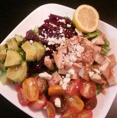 Simple salad with broccoli, avocado, beets, feta cheese, tomatoes. No dressing just lemon juice.
