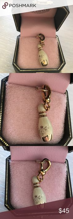 Juicy Couture bowling pin charm  One chip in the white enamel on the front. Perfect condition otherwise, box included. Thank you for looking!  I ship within 2 days shipping excluding holidays I do not trade! I only accept offers through the offer button! Thank you for shopping and feel free to ask any questions! Juicy Couture Jewelry Bracelets