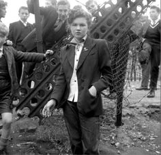 14 year old Jean Rayner surrounded by young aspiring Teddy Boys on a bombsite, January 1955