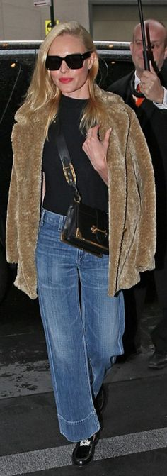 Kate Bosworth: Sunglasses – Celine  Purse – Prada  Jeans – Citizens of Humanity