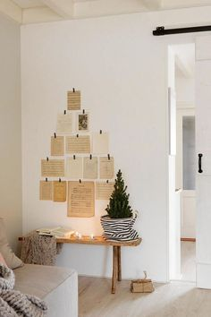 Create a wall tree using vintage sheet music or book pages