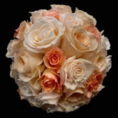 The softer side of orange. Bridal flowers pretty in peach.