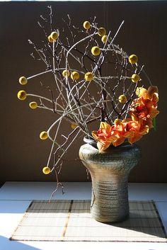 Armature of craspedia and manzanita flower arrangement