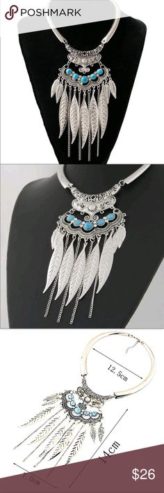 Boho Feather Necklace Gorgeous necklace! Will definitely turn heads! Silver toned zinc alloy. New in package. Jewelry Necklaces