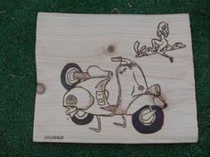 incisione a caldo su legno di ulivo