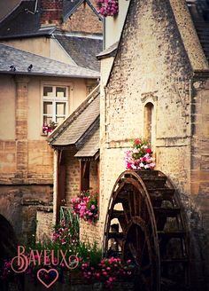 Bayeux, France. The water wheel adds something to the scene