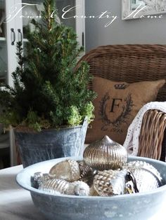 Farmhouse Christmas:  Galvanized bucket to hold vintage ornaments.