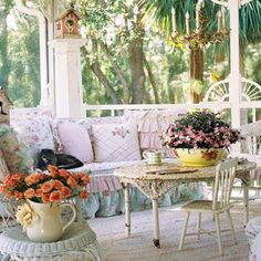Shabby chic porch. Has a very southern feel to it.