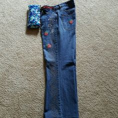 "Coldwater Creek Strawberry Bling Jeans Gorgeous Strawberry emblems and embroidered all the way down both legs! Pretty rhinestones in the strawberries and on back pockets.  Inseam 28.5"" 6in front zipper closure these come right to the belly button.  Wirn only a couple of times and they are in excellent condition. Coldwater Creek Pants Boot Cut & Flare"