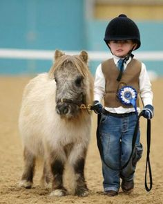 how adorable!! What a great way to grow up. With horses.... jm
