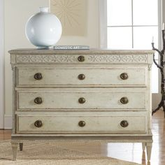 Timeless design and exceptional workmanship build the foundation for Modern History's collection of fine furniture. The sharp and sophisticated Gustavian commode offers stylish storage in the bedroom or living room. Detailed with classic carving and antiqued brass accents, this large chest boasts four drawers for stashing linens or other treasures. Handcrafted with high standards of construction and attention to detail, this piece is backed by a second-generation family tradition of…