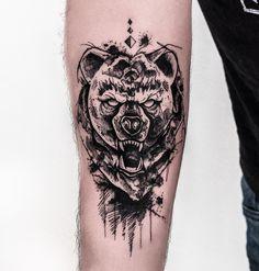 angry bear tattoo idea on the arm