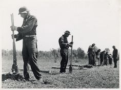 Civilian Conservation Corps boys putting up a fence in Greene County, Georgia; May 1941