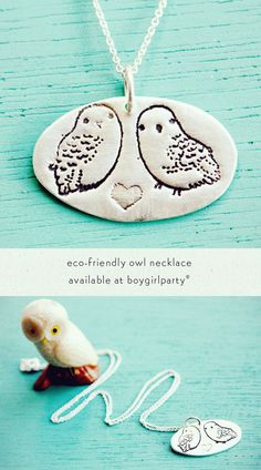 """Back by popular demand! This lovingly handmade sterling silver necklace features a pair of snowy owls and a heart pressed in an oval pendant. Comes on an 18"""" fine silver chain. Pendant measures approx"""
