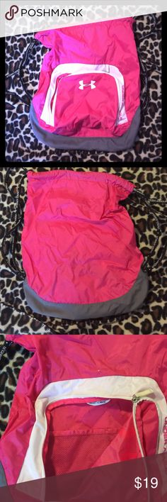Never use it. Only used it a couple times 4 gym. Hot pink Under Armour drawstring bag. (Gym bag) with front zipper pocket and inside zipper pocket. Small mark above zipper front pocket. Under Armour Bags Backpacks