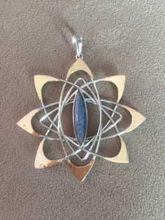Pleiadian Star Pendant with Kyanite, Silver & Gold- Large by LiquidFireMantra on Etsy https://www.etsy.com/listing/271813066/pleiadian-star-pendant-with-kyanite