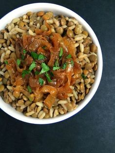 Lebanese Lentils and Rice (Mujaddara) via - A protein-packed side dish or vegetarian main, this humble dish of lentils and rice is topped with addictively delicious caramelized onions.