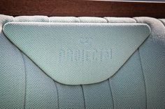 Embroidered detailing finishes the aft cockpit seating on board the refurbished Project 31@50. Elegant aqua blue fabric by @dedarmilano