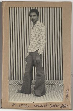 [Man Standing Before Striped Background] Malick Sidibé (Malian, born Africa Art, West Africa, Africa Style, Black Image, Black N White Images, Photographs Of People, Vintage Photographs, Afro, Vintage Black Glamour