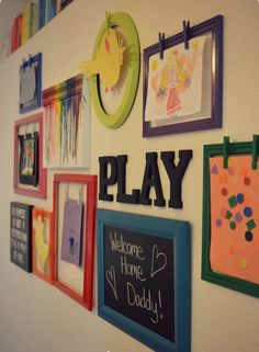 Playroom gallery wall with rotating artwork display. Post includes tutorials for making frames, crayon art, & chalkboard + genius tips for how to arrange & hang a gallery wall!