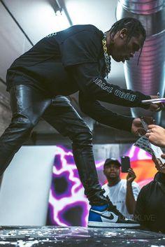 YSL Trousers and Jordan 1 Sneakers. Travis always kills it.
