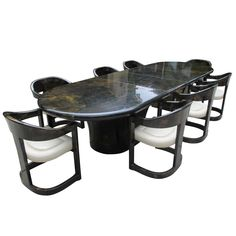 Rare Karl Springer Extension Dining Table with Eight Onassis Chairs | From a unique collection of antique and modern dining room sets at https://www.1stdibs.com/furniture/tables/dining-room-sets/