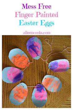 Have you tried mess free finger painting with your kids? It is so much fun and keeps their hands and clothes clean! Mess Free Finger Painted Easter Eggs are a great way to decorate for Easter with your kids! via @aileencooks