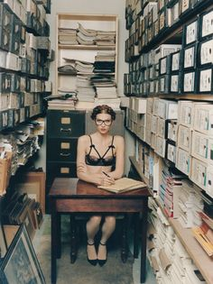 My dream job. Archival storage. The smell. Imposing order. If only we could dress like that ;-)