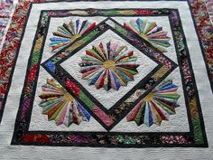 Dresden Bloom. Pieced by Mavis Aston-Hunt. Quilted by Jessica's Quilting Studio