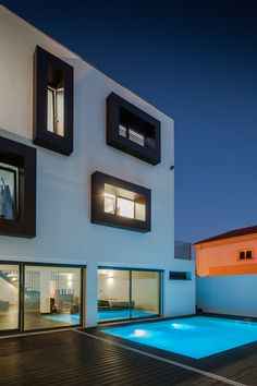 "ML House ""A private home in Portugal with a box body and box windows"" 