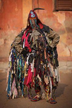 Brilliant image. This is listed as a Yoruba Egungun costume.