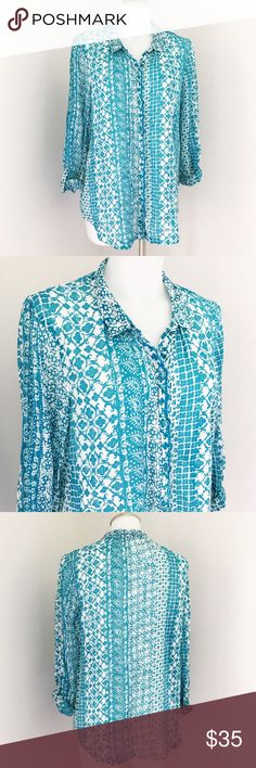 """Anthropologie Hei Hei Blue White Floral Top Super cute button down top by Anthropologie brand Hei Hei. Shirt has a collar, roll up long sleeves which secure with a buttoned strap, shirt buttons down all the way. Print is a bluish-Green-teal Floral design on a white background. Light and comfy, great for Spring and Summer! Great preowned condition, no flaws! Measurements when laid flat: bust is about 21"""", length is about 28"""". Meant to fit a little loose. Anthropologie Tops Button Down Shirts"""