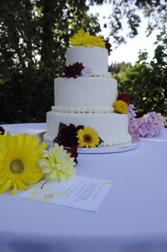 Simple wedding cake with real flowers