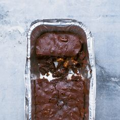 Emergency brownies: This is for those times you urgently need a brownie, but don't want to make (or, rather, can't justify making) a whole batch. This recipe makes two (four if needs be) fudgy brownies to be snaffled straight from the tin. It is worth keeping takeaway-style foil tins in the house just to make these. Take my word for it, it will be a frequent occurrence. #AtMyTable #nigella