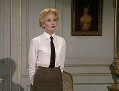 Kim Hartman as Private Helga Geerhart, in Allo Allo; Pretty Maids All in a Row Black Suit White Shirt, Black Suits, School Girl Outfit, Girl Outfits, Vicki Michelle, German Women, British Comedy, Good Looking Women, Trade Show