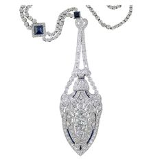 Art Deco Diamond and Sapphire Platinum Lavaliere Necklace | From a unique collection of vintage drop necklaces at http://www.1stdibs.com/necklaces/drop-necklaces/