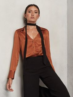 So, we're calling this one a top but it's really a full blown blouse. You know the type. Designed to make you feel like a sexy lady, and cut to fit you just right. https://www.thereformation.com/products/soleil-top-cognac?utm_source=pinterest&utm_medium=organic&utm_campaign=PinterestOwnedPins